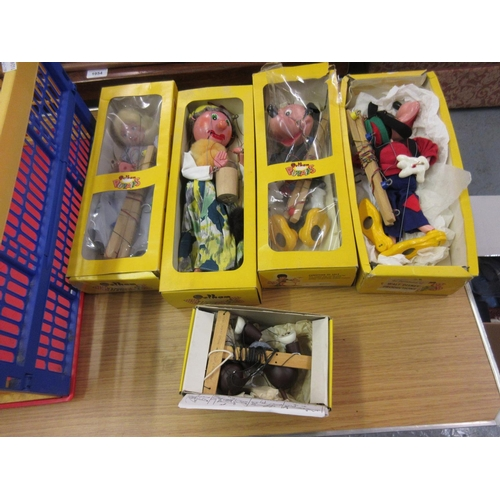 292 - Two boxed Pelham puppets, Mickey Mouse and Goofy, with three further boxed puppets, Old Lady, Fairy ...