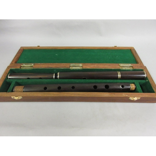 295 - Rosewood four section flute in later fitted box...
