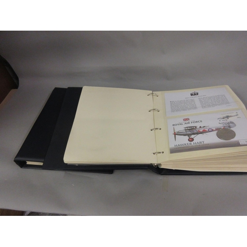301 - Two blue albums containing a collection of various Royal Air Force First Day cover stamps and coins ...