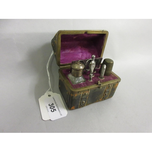 305 - Small early 20th Century leather and brass studded casket containing a sewing kit / manicure set...
