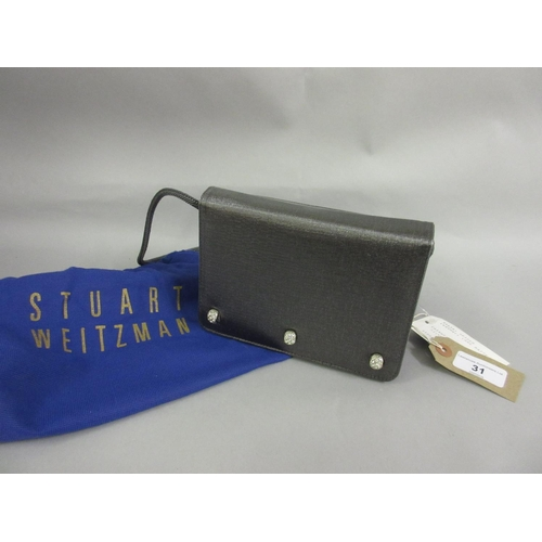 31 - Stuart Weitzman, Spider evening bag in pewter fabric with cord shoulder strap, having original dust ...