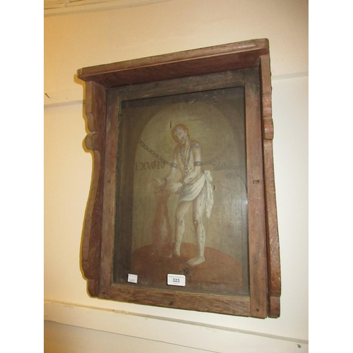 323 - 18th Century oak and glazed tabernacle cabinet painted with a manacled man dated 1746...