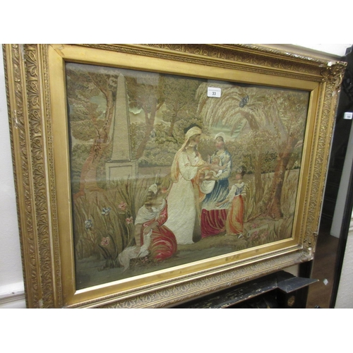 33 - 19th Century Berlin silkwork picture depicting ladies and a child in a landscape, gilt framed, 18ins...