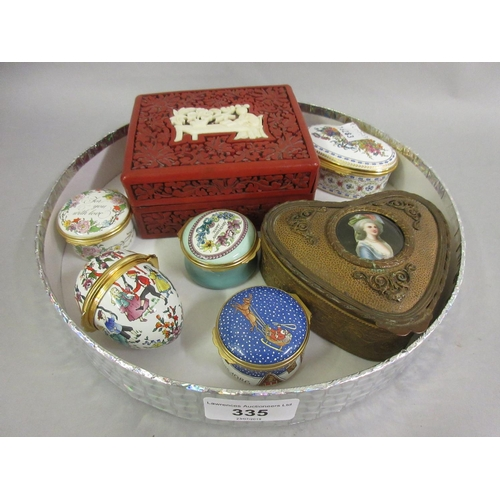 335 - Group of five Halcyon days enamel boxes, gilt metal trinket box with porcelain inset lid and a red c...