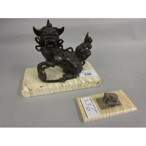 336 - Chinese dark patinated bronze figure of a seated dog of foe on a mammoth tooth base together with a ...