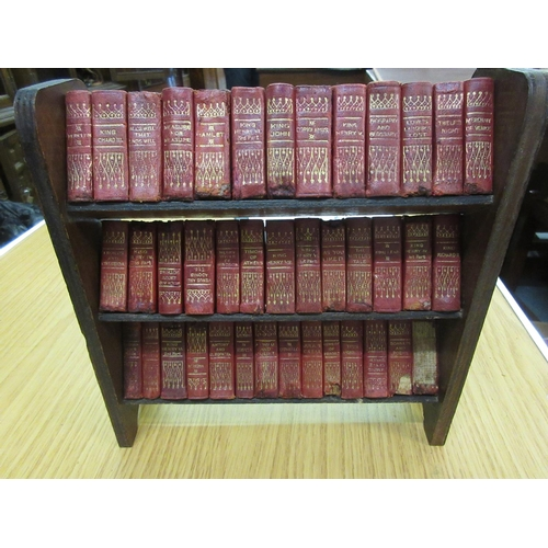 384 - Miniature bookcase containing set of miniature red leather bound volumes, ' Works of Shakespeare '...