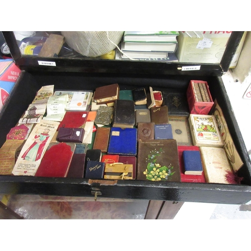 392 - Table top glazed display cabinet containing various miniature books etc...