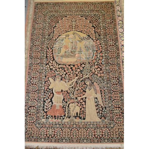 4 - Indo Persian silk rug, the central panel of figures having all-over floral design on a black ground ...