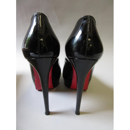 40 - Christian Louboutin, pair of black patent leather Bianca 140 platform shoes, with one original dust ...