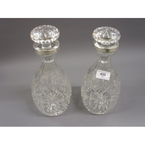 433 - Pair of good quality cut glass decanters with stoppers with white metal collars...