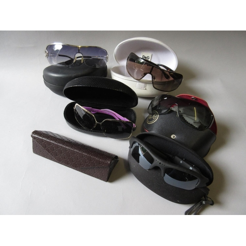 44 - Small quantity of various designer sunglasses including Ray-Ban, Dolce & Gabbana, Dior, Armani, a Gu...