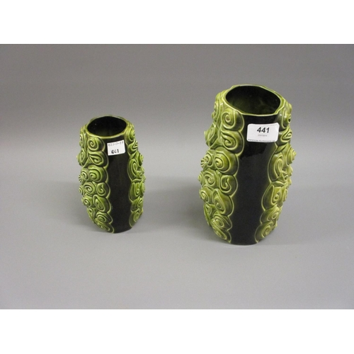 441 - Two Sylvac green pottery relief moulded vases...