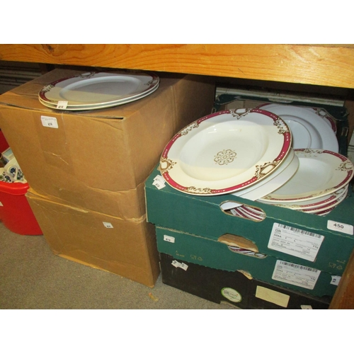 450 - Five boxes containing a large late 19th Century dinner service having gilt decoration on white groun...