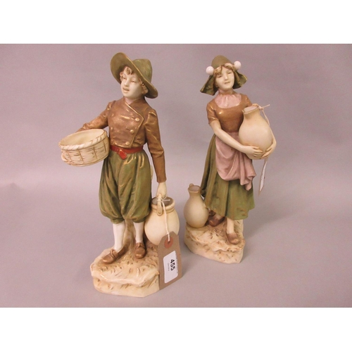455 - Pair of Royal Dux figures of a Dutch boy and girl in traditional costume, 10ins high approximately, ...