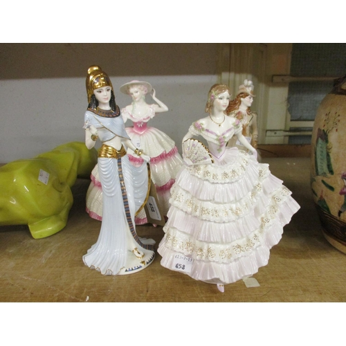 458 - Coalport figure, ' Cleopatra ' and Royal Worcester figure,  ' Belle of the Ball ' with two other fig...