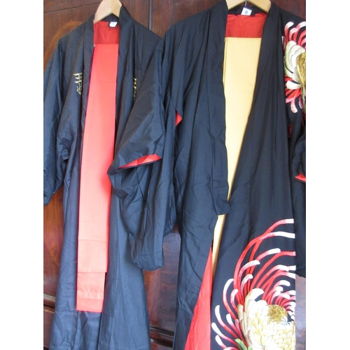 46 - Two late 20th Century embroidered silk kimono robes with sashes...