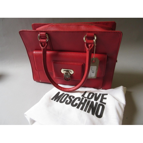 47 - Love Moschino, red leather handbag having pocket to front with silver metal padlock style clasp and ...