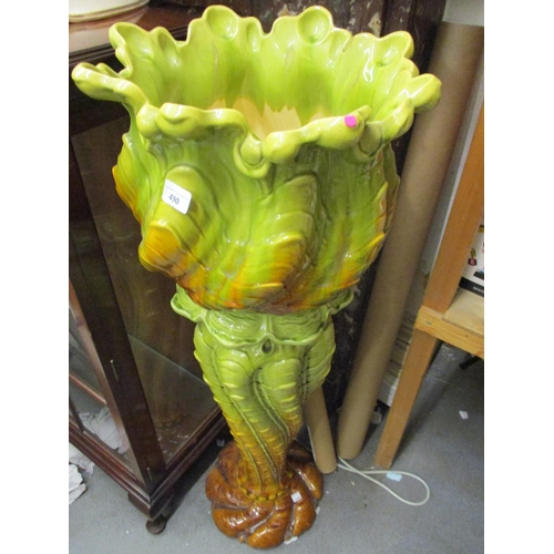490 - Large Victorian green and yellow glazed relief decorated pottery jardiniere and stand...