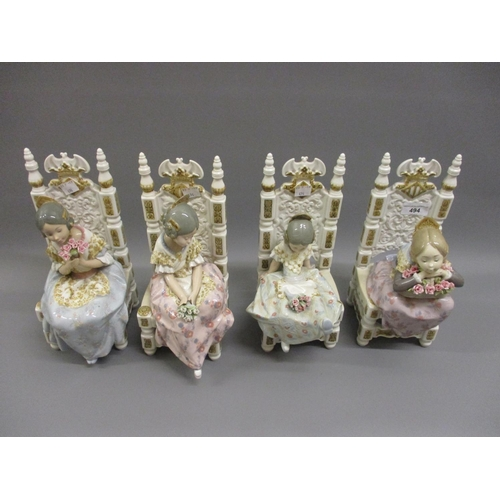 494 - Group of four modern Lladro figures, each of a girl seated in a high back chair and holding a posy o...