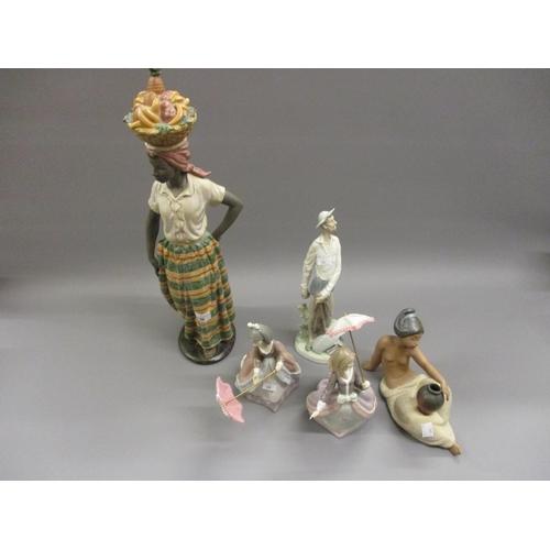 496 - Nao matt glazed figure of a West Indian girl carrying a basket of fruit, a Lladro figure of Don Quix...