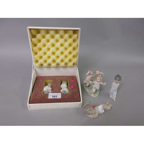 503 - Two miniature Lladro figures of boy angels, boxed and three similar figures (no boxes)...