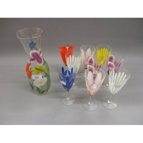 522 - 1950's hand painted floral decorated drinking set comprising: carafe and nine glasses...