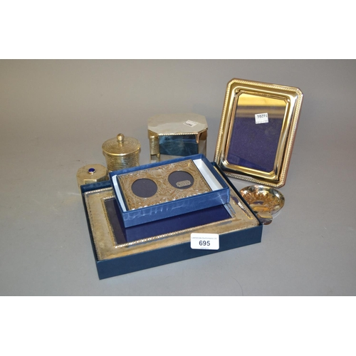695 - Two small modern silver photograph frames, together with a small quantity of silver plate including ...
