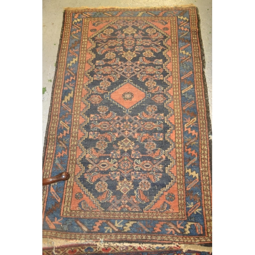 7 - Late 19th/early 20th Century rug having various gols and floral decoration on a blue ground with mul...