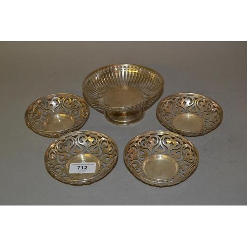 712 - Birmingham silver circular pedestal bonbon dish and a set of four Birmingham silver pierced trinket ...