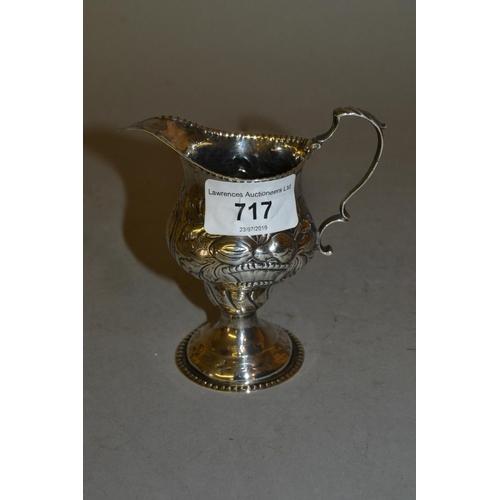 717 - George III silver floral embossed pedestal cream jug, makers mark B.M....