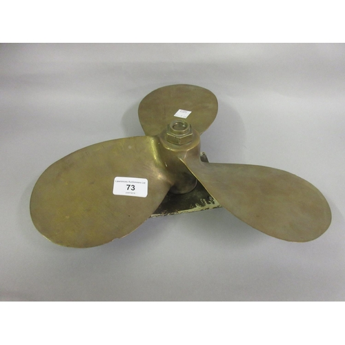 73 - Ship's brass propeller...