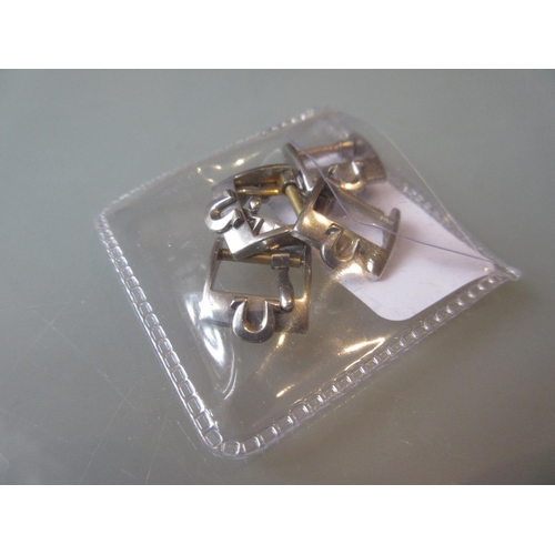 783 - Group of five Omega watch strap buckles...