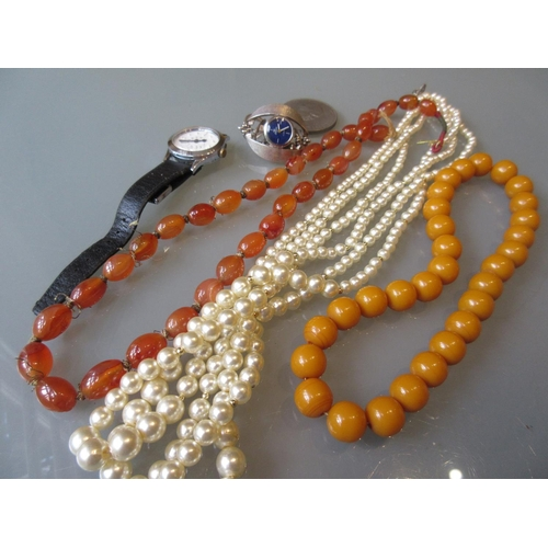 793 - Agate bead necklace, an amber coloured bead necklace, simulated pearl necklace, two wristwatches and...