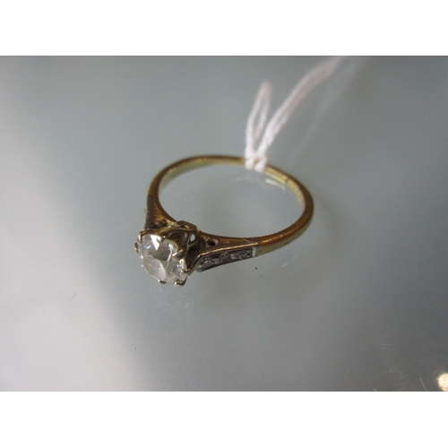 798 - 18ct Yellow gold and platinum set solitaire ring with chip set shoulders...