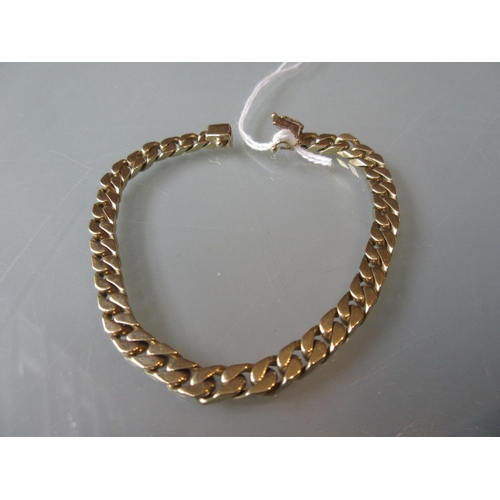 806 - 9ct Yellow gold curb link bracelet...