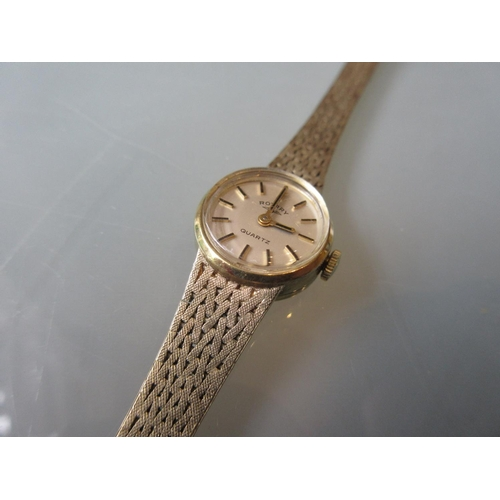 807 - Ladies 9ct gold cased wristwatch by Rotary with an integral articulated bracelet...