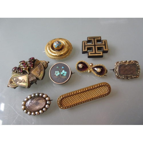 815 - Victorian yellow metal enamel and split pearl circular brooch, gilt metal and garnet set brooch, a p...