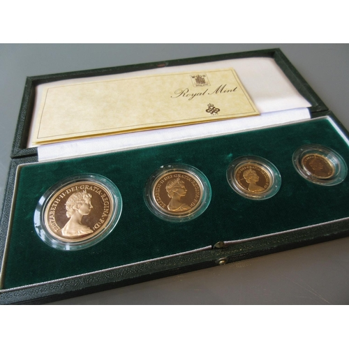 821 - U.K, 1980 gold proof coin set comprising: five pounds, two pounds, sovereign and half sovereign, in ...