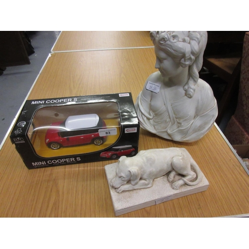 83 - Boxed radio controlled model of a Mini Cooper S together with a composition figure of the Arlington ...