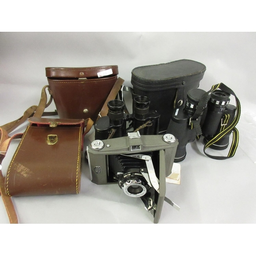 84 - Two cased pairs of binoculars together with a Ross Ensign camera...