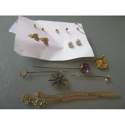 845 - Three various Victorian stick pins, yellow metal pendant, silver gilt spider pendant on chain and a ...