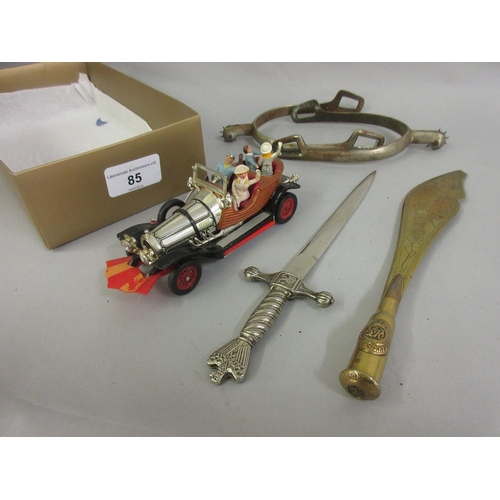85 - Corgi Toys Chitty Bang Bang, a World War I Trench Art paper knife, paper knife in the form of a Thir...