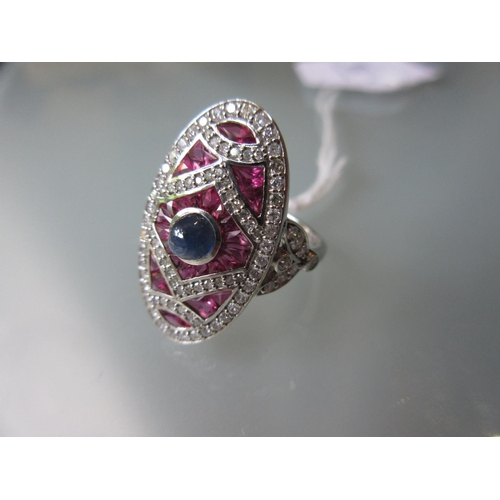 855 - 18ct White gold and platinum large Art Deco style ring set rubies, diamonds and a cabochon sapphire...
