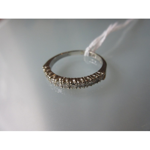 858 - 18ct White gold half eternity ring set eleven diamonds...