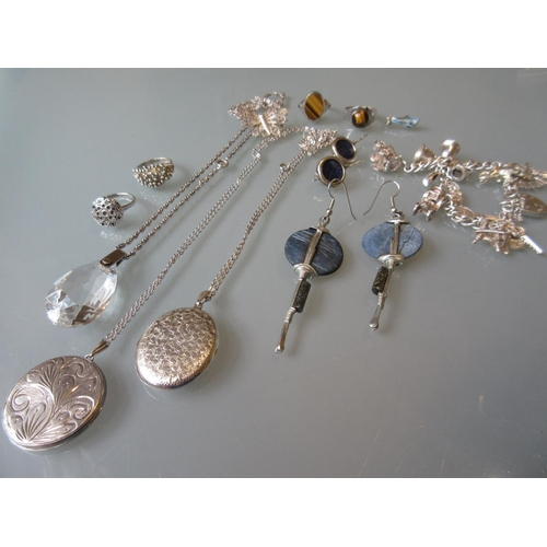 862 - Quantity of silver jewellery including a charm bracelet and pendant locket...