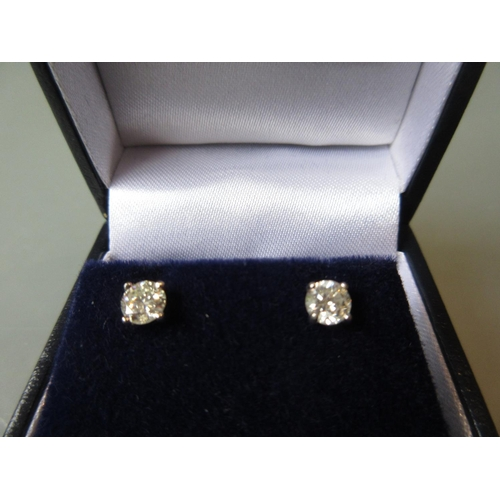872 - Pair of 18ct white gold solitaire stud earrings approximately 0.65ct total...