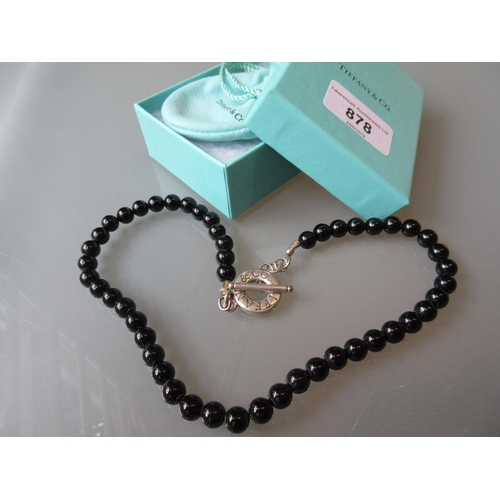 878 - Tiffany & Co. black bead necklace with silver clasp, in original bag and box...