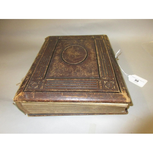 88 - 19th Century leather bound photograph album containing a quantity of Victorian photographs (at fault...