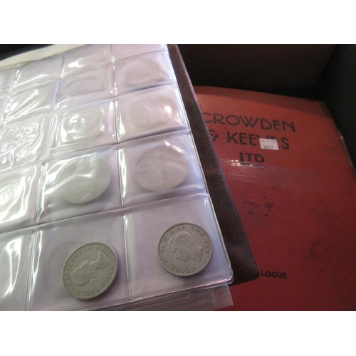 880 - Two albums containing a collection of various pre-decimal British coinage and crowns...