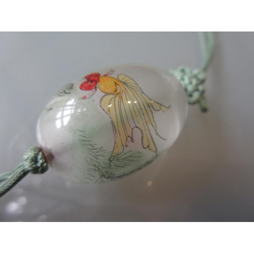 897 - Two Chinese Deco style glass pendants internally painted with fish and a landscape...